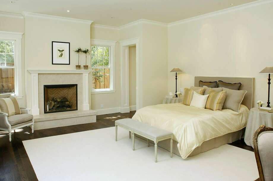 The master suite includes a fireplace and a shower area leading to the pool. Photo: Patrick Carney