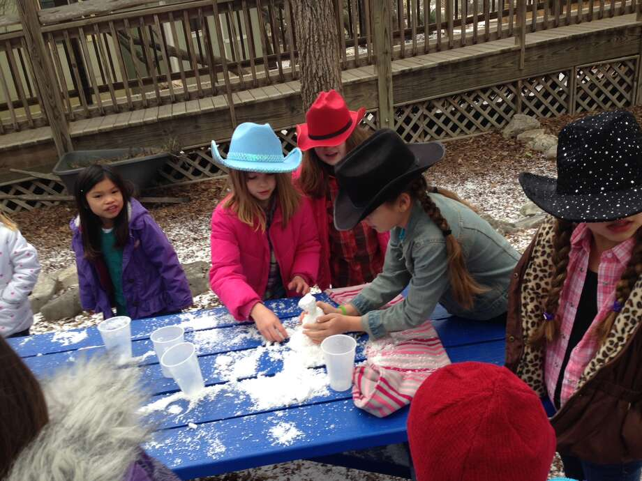 Students at Buckner Fanning Christian School take a break after their rodeo breakfast to make a mini snowman. Photo: LeAnna Kosub