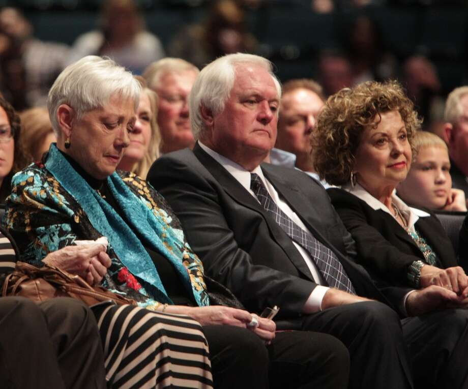 Bum Phillips' widow Debbie Phillips and his son Wade Phillips, and Wade's wife Laurie Phillips attend Bum Phillips Memorial Service at Lakewood Church on Oct. 29, 2013. Photo: James Nielsen, Houston Chronicle