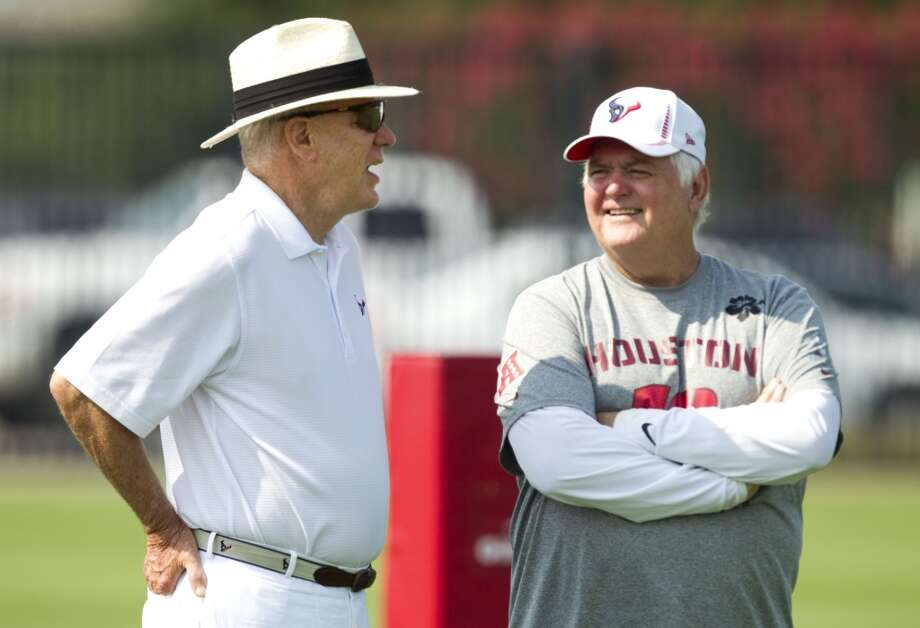 Texans owner Bob McNair, left, talks to Wade Phillips during Texans Organized Team Activities on June 7, 2012. Photo: Brett Coomer, Houston Chronicle
