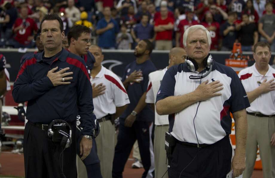 Gary Kubiak, left, and Wade Phillips and stand for the national anthem before the Texans 17-10 win over the Atlanta Falcons on Dec. 4, 2011 at Reliant Stadium. Photo: Brett Coomer, Houston Chronicle