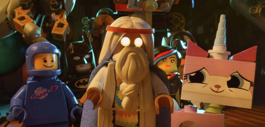 "This image released by Warner Bros. Pictures shows characters, from left, Benny, voiced by Charlie Day, Batman, voiced by Will Arnett, Vitruvius, voiced by Morgan Freeman, Wyldstyle, voiced by Elizabeth Banks and Unikitty, voiced by Alison Brie, in a scene from ""The Lego Movie."" (AP Photo/Warner Bros. Pictures) ORG XMIT: NYET126 Photo: Courtesy Of Warner Bros. Pictures / Warner Bros. Pictures"