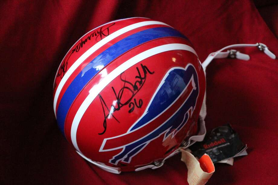 Buffalo Bills' helmet autographed by former Houston great Antowain Smith and NFL Hall of Famer Thurman Thomas is among the items being auctioned by UH Athletics.