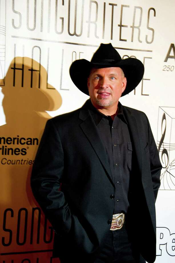 FILE - In this June 16, 2011, file photo inductee Garth Brooks arrives at the 42nd Annual Songwriters Hall of Fame Awards in New York. The Country music star is suing an Oklahoma hospital that he says reneged on a promise to name a building after his late mother in exchange for a $500,000 donation. The trial at the Rogers County District Court begins Tuesday, Jan. 17, 2012.  (AP Photo/Charles Sykes) Photo: Charles Sykes / AP2011