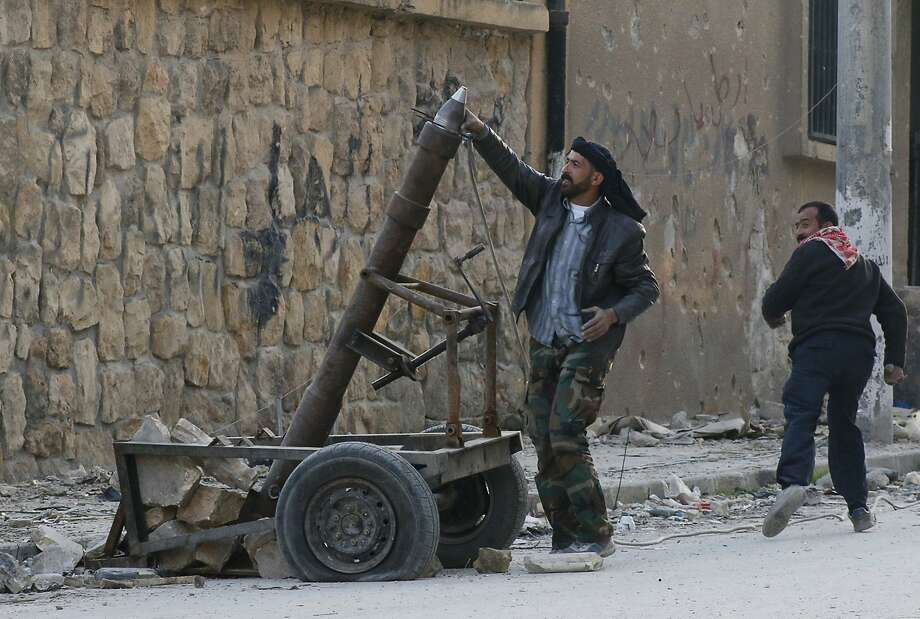 A Free Syrian Army fighter prepares to fire mortar shells in Aleppo's Karm al-Jabal district. Photo: Saad Abobrahim, Reuters