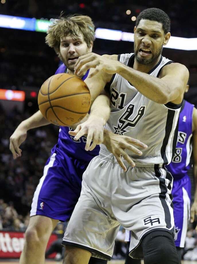 Sacramento Kings' Aaron Gray and San Antonio Spurs' Tim Duncan grab for a loose ball during first half action Saturday Feb. 1, 2014 at the AT&T Center. Photo: Edward A. Ornelas, San Antonio Express-News
