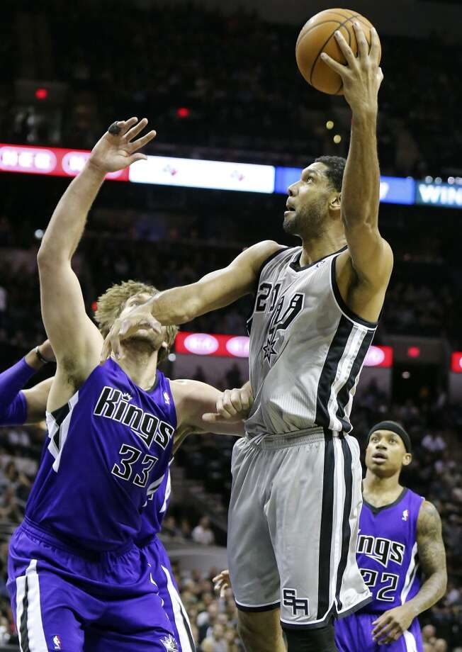 San Antonio Spurs' Tim Duncan shoots around Sacramento Kings' Aaron Gray during first half action Saturday Feb. 1, 2014 at the AT&T Center. Photo: Edward A. Ornelas, San Antonio Express-News