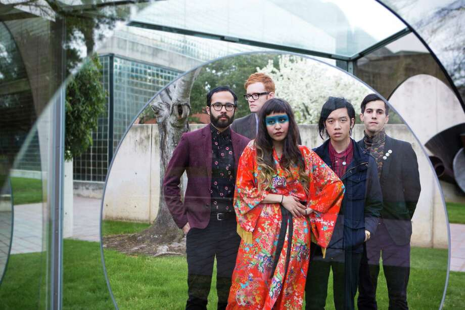 "Indie-pop band Wild Moccasins, at the Cullen Sculpture Garden at the Museum of Fine Arts, Houston, are, from left, Nicholas Cody, John Baldwin, Zahira Gutierrez, Andrew Lee and Cody Swann. New album ""88 92"" was released Tuesday. Photo: Marie D. De Jeséºs, Staff / © 2014 Houston Chronicle"