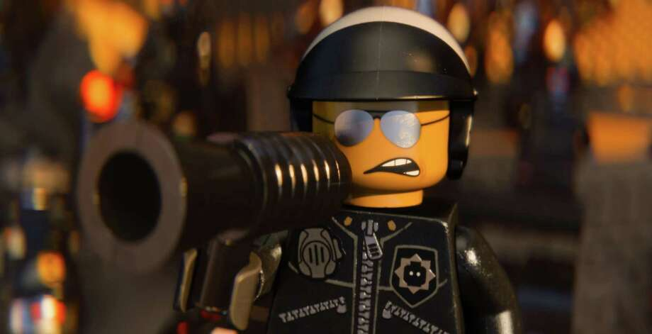 "This image released by Warner Bros. Pictures shows the character Bad Cop/Good Cop, voiced by Liam Neeson, in a scene from ""The Lego Movie."" (AP Photo/Warner Bros. Pictures) Photo: Courtesy Of Warner Bros. Picture, HOEP / Warner Bros. Pictures"