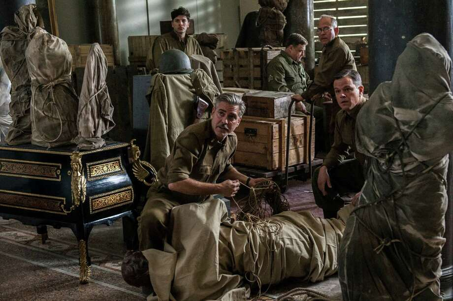 "This image released by Columbia Pictures shows, from left, Dimitri Leonidas, George Clooney, John Goodman, Bob Balaban and Matt Damon in ""The Monuments Men."" (AP Photo/Columbia Pictures, Claudette Barius) Photo: Claudette Barius, HOEP / Columbia Pictures - Sony"