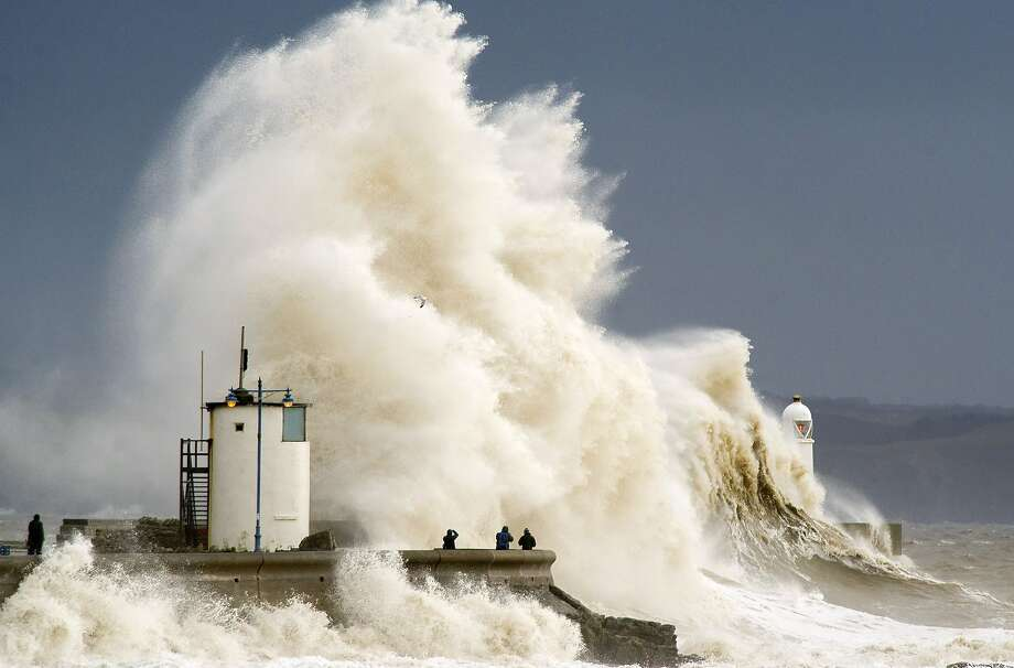 The UK's mistreated lighthouses: Tuesday it was the Newhaven Lighthouse that was getting battered by a monster wave, now it's the lighthouse in Porthcawl, Wales, that's being pummeled. High tides combined with gale force winds 