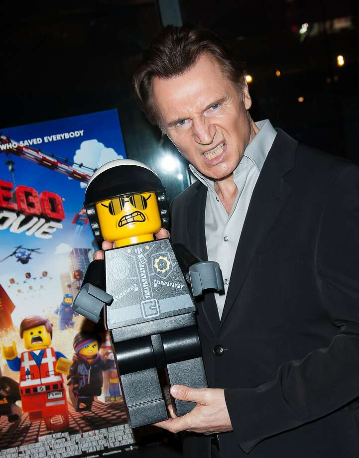 "Robocop has nothing on LEGO cop: A grimacing Liam Neeson hams it up during a screening of ""The LEGO Movie"" at AMC Empire 25 in New York City. The 
