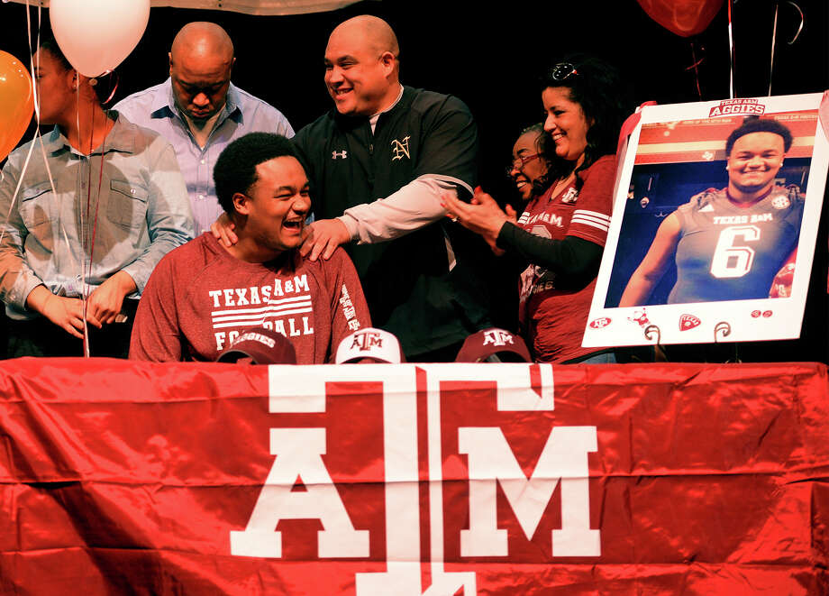DeShawn Washington after signing a letter of intent to Texas A&M at Nederland High School on Wednesday. Photo taken Wednesday, February 05, 2014 Guiseppe Barranco/@spotnewsshooter Photo: Guiseppe Barranco, Photo Editor