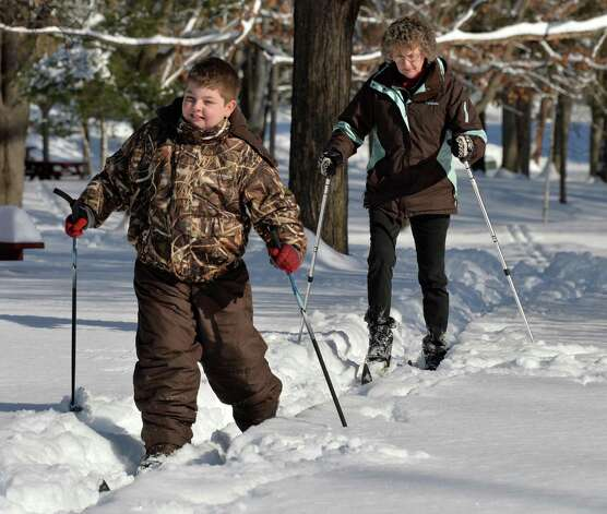 Ten-year-old Brian Hausman and his grandmother Diane Young, both of Guilderland, crosscountry ski through Tawasentha Park Thursday afternoon, Feb. 6, 2014, in Guilderland, N.Y.  (John Carl D'Annibale / Times Union) Photo: John Carl D'Annibale / 00025651A