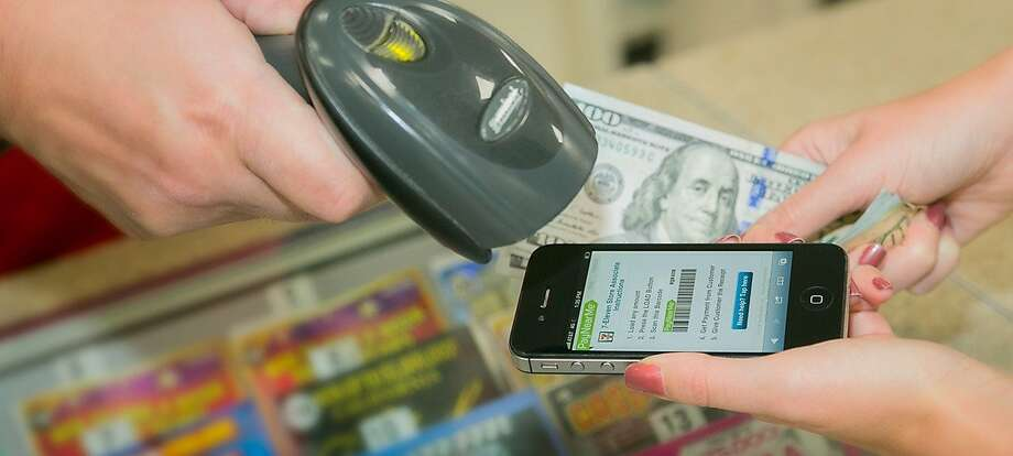 PayNearMe allows users without a bank account to pay cash for bills or purchases at participating businesses and agencies. Photo: PayNearMe
