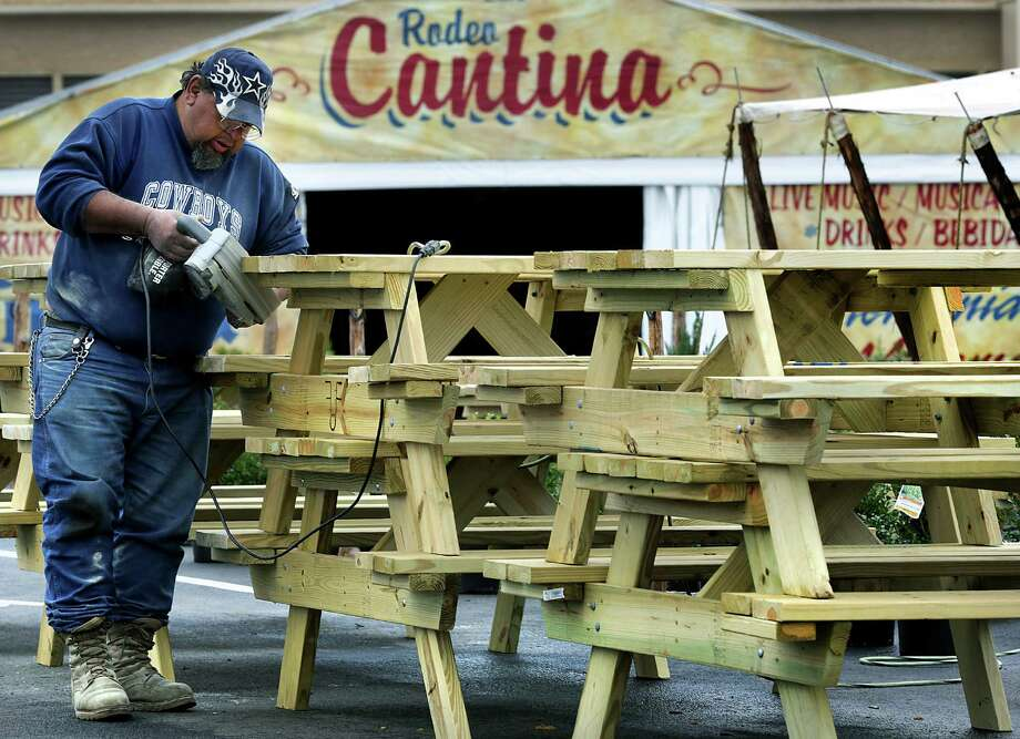 James Diaz, a volunteer worker at The San Antonio Stock Show and Rodeo, sands off the edges of some of the 30 new picnic tables that he and other volunteers made, gearing up for the opening of the stock show on Thursday.  Tuesday, Feb. 4, 2014. Photo: BOB OWEN, San Antonio Express-News / © 2012 San Antonio Express-News
