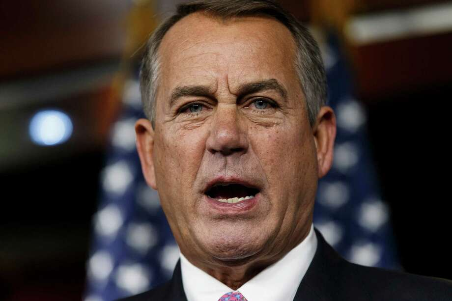 House Speaker John Boehner of Ohio speaks during a news conference on Capitol Hill in Washington, Thursday, Feb. 6, 2014. Boehner said Thursday it will be difficult to pass immigration legislation this year, dimming prospects for one of President Barack Obama's top domestic priorities.  (AP Photo/J. Scott Applewhite) Photo: J. Scott Applewhite, STF / AP