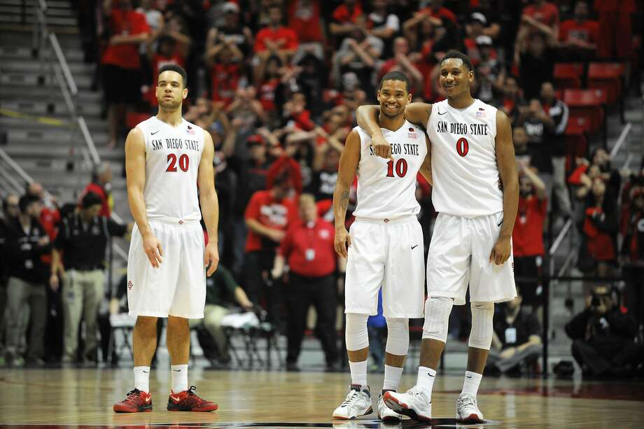 San Diego State's JJ O'Brien (20), Aqeel Quinn (10), and Skylar Spencer (0) look on late in the second half of an NCAA college basketball game against Colorado State on Saturday, Feb. 1, 2014, in San Diego.  (AP Photo/Denis Poroy) Photo: Denis Poroy, Associated Press