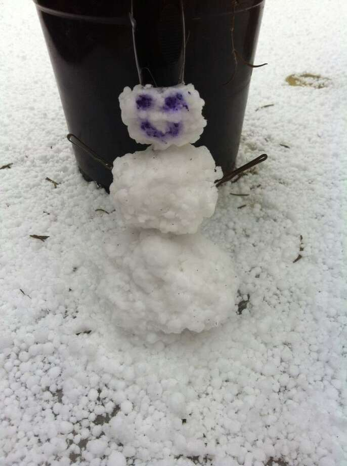 This photo taken in Encino Creek, near Bulverde and Evans roads, shows a graupel snowman in San Antonio on Thursday, Feb. 6, 2014. Photo: Courtesy Photo/Sara Milam