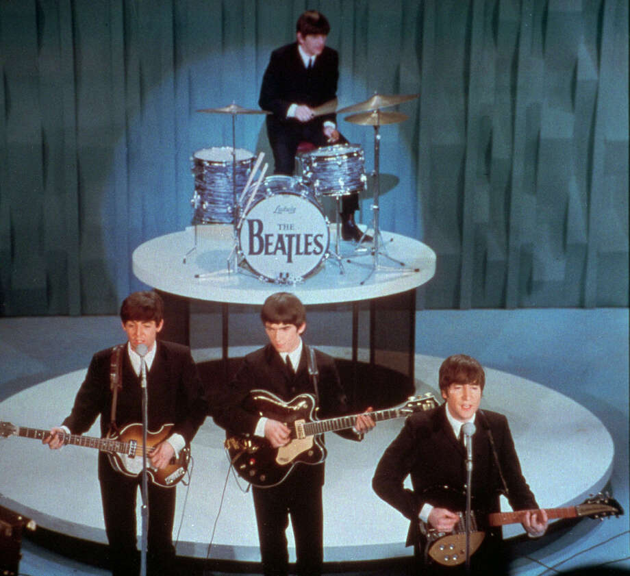 "The Beatles perform on the otherwise-stodgy ""The Ed Sullivan Show,"" on Feb. 9, 1964. Though the performance was a half-century ago, its impact still reverberates today. Photo: Associated Press File Photo / FILE"