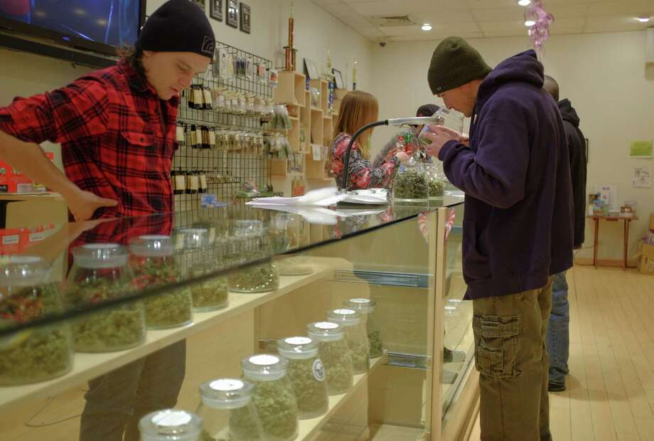 A medical marijuana store in Denver: Texas isn't there — medical use and retail sales. But Gov. Rick Perry has broached a discussion on our still-draconian pot laws. Photo: Matthew Staver / New York Times / NYTNS