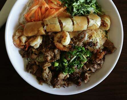 "Pho (fuh): A traditional Vietnamese rice-stick noodle dish served in a clear broth with vegetable accompaniments. Audio: Click here to hear the term ""Pho."" / © 2012 San Antonio Express-News"