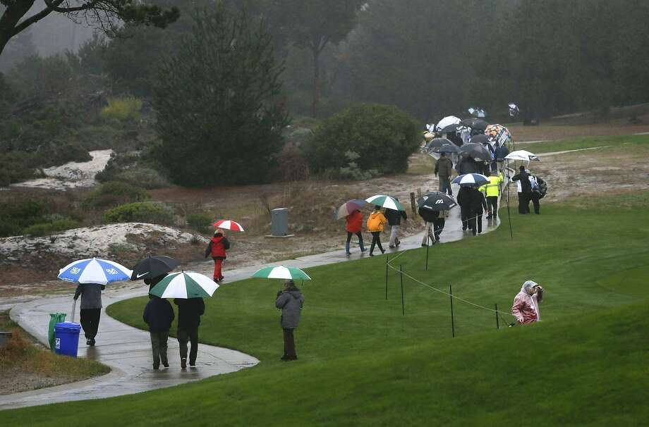Rain delayed the AT&T Pebble Beach National Pro-Am, resulting in 40 pros being unable to finish the first round. Photo: Michael Macor, The Chronicle