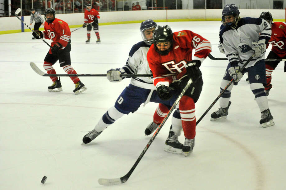 Darien's Nicholas Allam coillides with Fairfield Prep's Matt McKinney during their hockey game at Darien Ice Rink in Darien, Conn., on Feb. 6, 2014. Darien won in overtime, 3-2. Photo: Jason Rearick / Stamford Advocate