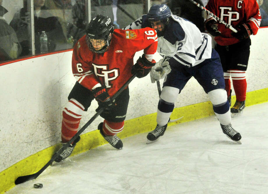Fairfield Prep's John Hoey keeps the puck from Darien's Tiger Sullivan during their hockey game at Darien Ice Rink in Darien, Conn., on Feb. 6, 2014. Darien won in overtime, 3-2. Photo: Jason Rearick / Stamford Advocate
