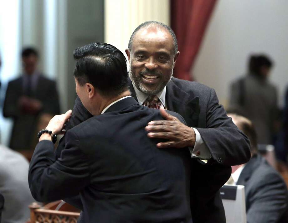 State Sen. Roderick Wright, D-Inglewood, right, is greeted by Sen. Leland Yee, D-San Francisco, on his first day in the Senate after his conviction for perjury, at the Capitol in Sacramento in February. The corruption and bribery charges leveled against state Senator Yee are the third embarrassing scandal this year for state Senate Democrats. Photo: Rich Pedroncelli, Associated Press