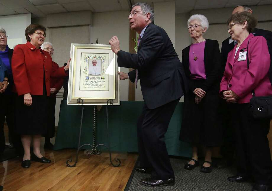 Dr. Paul Klotman, center, president and CEO for Baylor College of Medicine, jokes that it took a Jewish man to get a papal blessing for Children's Hospital of San Antonio. At left is Sister Yolanda Tarango, and at right is Sister Sara Lennon and Sister Margaret Carew during the Feb. 3 unveiling of the blessing sent from Pope Francis. Photo: Bob Owen / San Antonio Express-News / © 2012 San Antonio Express-News