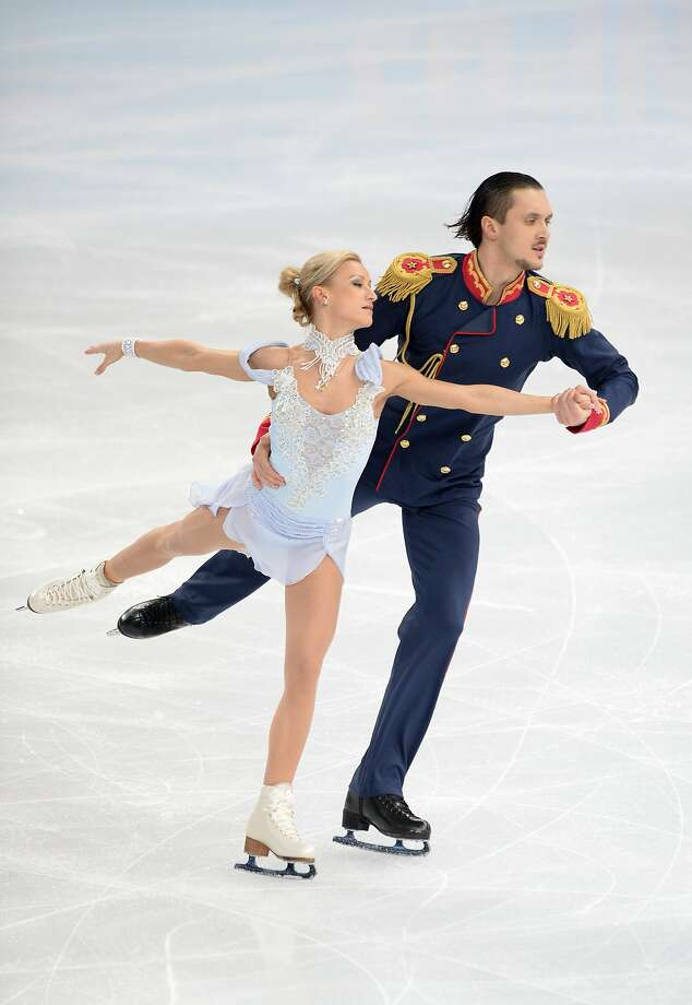 Maxim Trankov and Tatiana Volosozhar stole the show during the pairs team short program. Photo: Jung Yeon-je, AFP/Getty Images
