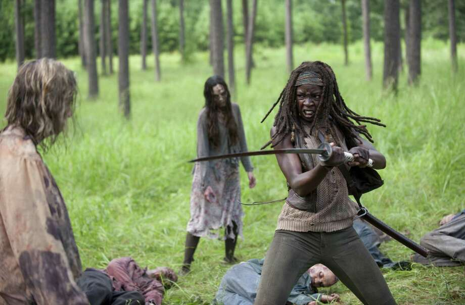 "The midseason opener of ""The Walking Dead"" offers fascinating insights into the background and psyche of sword-wielding Michonne (Danai Gurira). Photo: AMC / San Antonio Express-News"