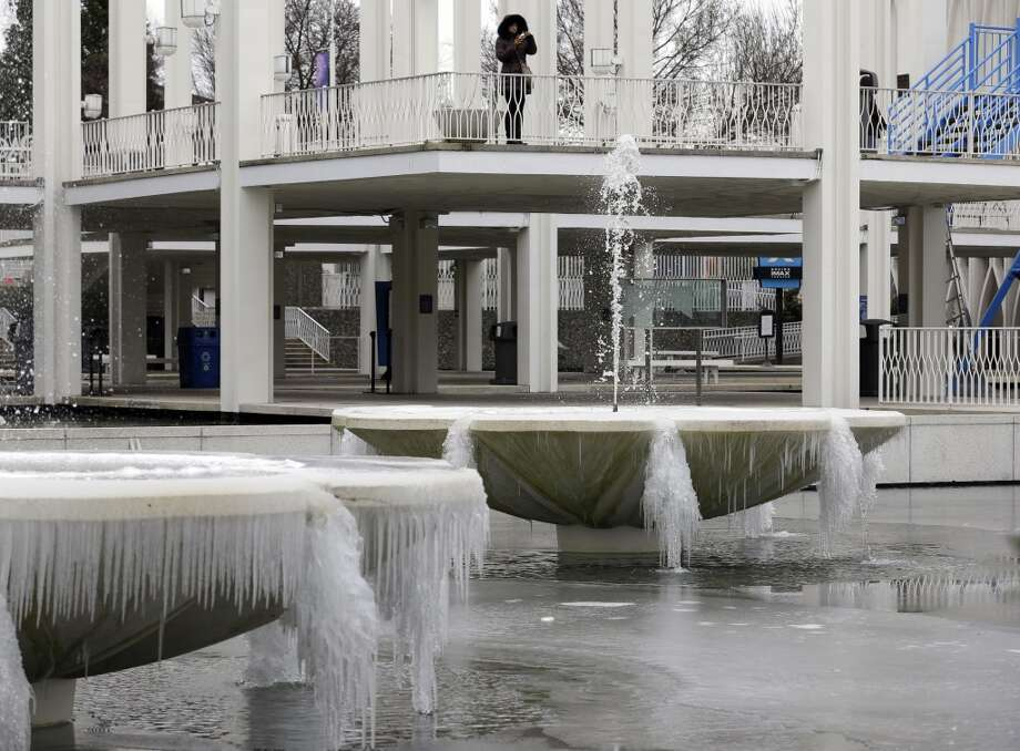 The fountains at the Pacific Science Center are caked with ice on Thursday, Feb. 6, 2014. Below-normal, frigid temperatures are forecast to continue in Seattle into the weekend. (AP Photo/Ted S. Warren) Photo: Ted S. Warren, AP