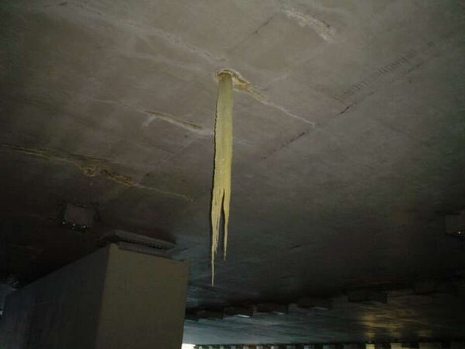 "Ugh, what's that?! It's a giant, yellow icicle inside the I-90 tunnel in Mercer Island. State transportation workers said water had seeped through a ""weep hole"" in the tunnel and froze into a death-trap-looking thing, before it was removed.   Why yellow? WSDOT said it was due to a combination of dirt and algae. (Photo: WSDOT). Photo: Working On Getting A Pic Of Convention Center Icicle. Here's One That Was Hanging From I-90 Mercer Island"