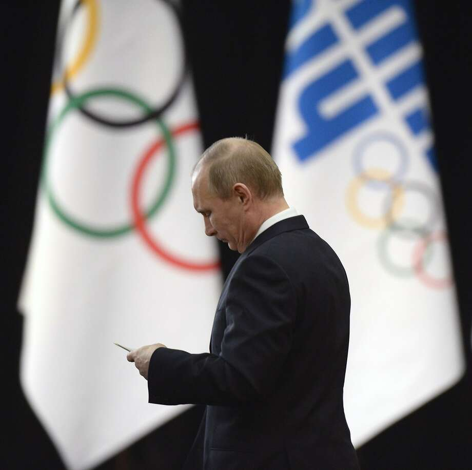 Russian President Vladimir Putin arrives at an IOC welcome event Tuesday in Sochi. Photo: Alexander Nemenov, AFP/Getty Images