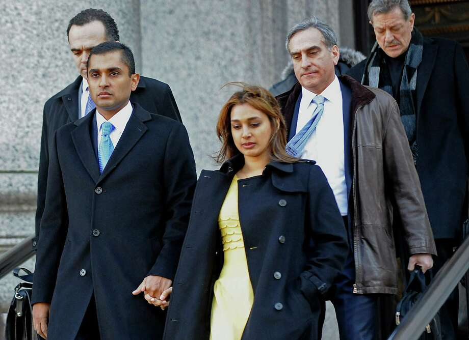 Mathew Martoma, foreground, leaves federal court with his wife, Rosemary Martoma, and his attorneys. Photo: Louis Lanzano / © 2014 Bloomberg Finance LP