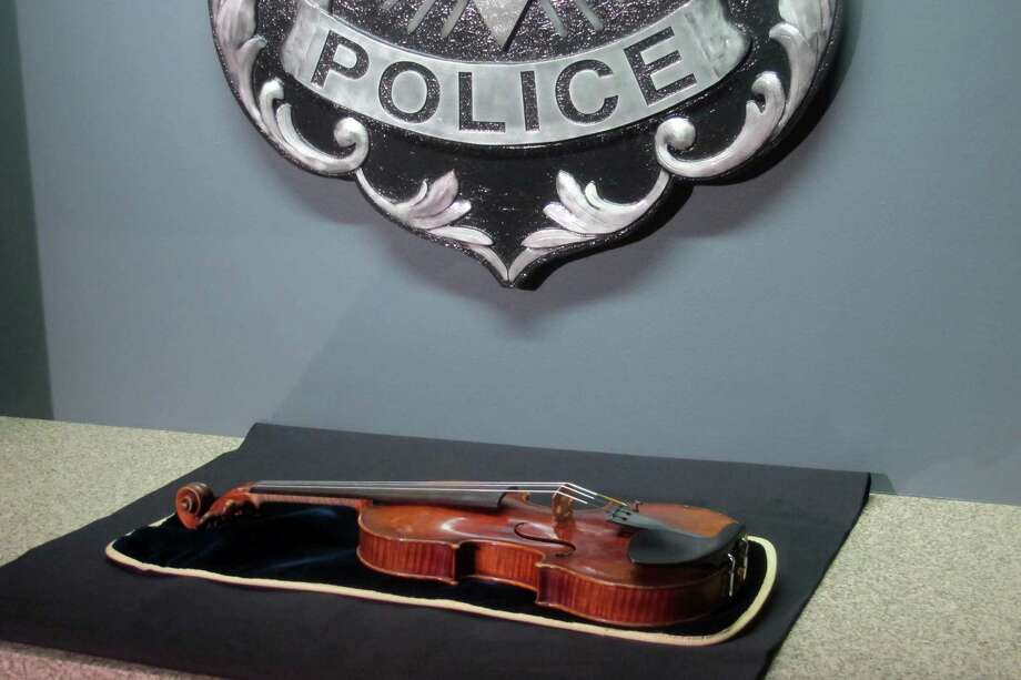 A $5 million Stradivarius violin is displayed at the Milwaukee Police Department on Thursday. Photo: Dinesh Ramde, STF / AP