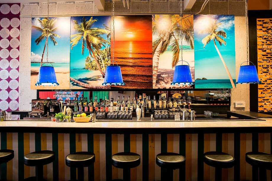 Tropical scenes overlook the bar in Lolo's new location on Valencia Street in San Francisco. Photo: Aubrie Pick Photography