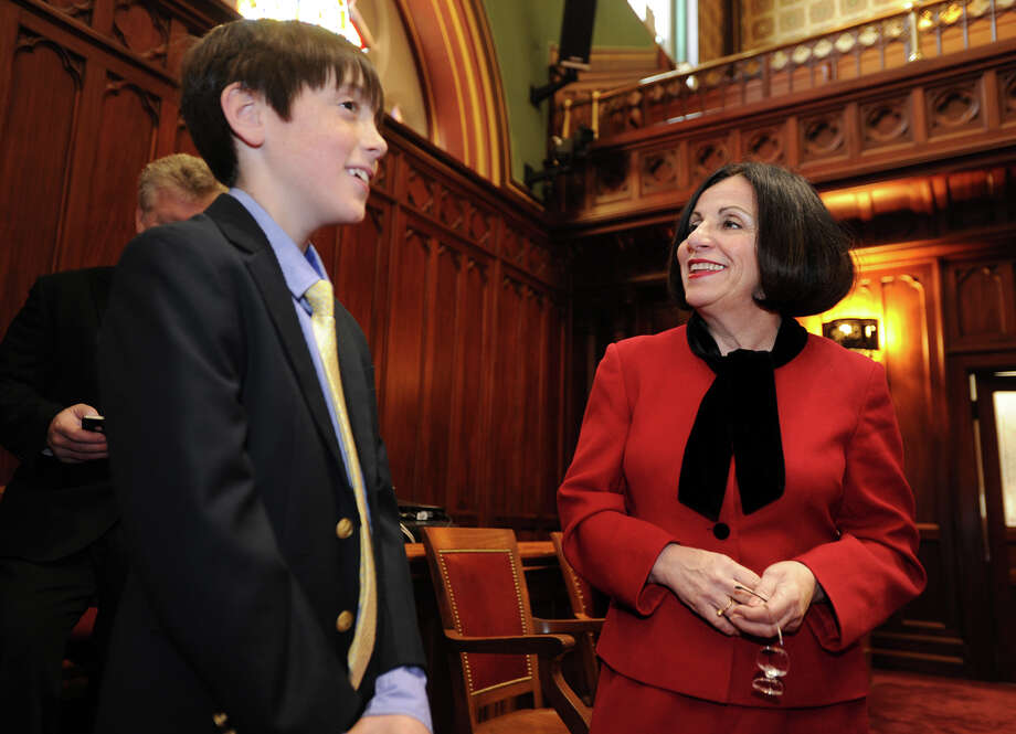 Sen. Toni Boucher, ranking member of the Education Committee and Higher Education Committee, right, gives a tour of senate chambers to constituent Luke Hoeing, 11, of Redding, at the Capitol in Harford, Conn. on Thursday, February 6, 2014. Photo: Brian A. Pounds / Connecticut Post