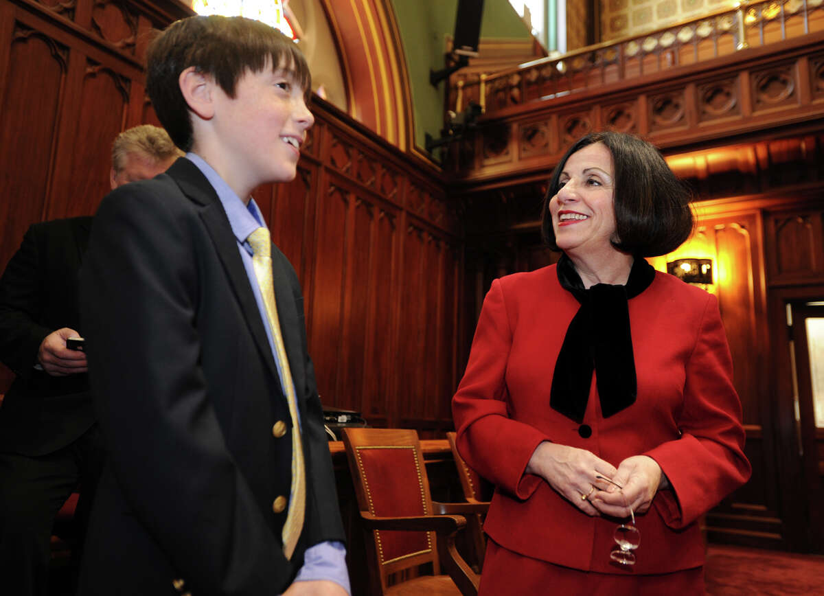 Sen. Toni Boucher, ranking member of the Education Committee and Higher Education Committee, right, gives a tour of senate chambers to constituent Luke Hoeing, 11, of Redding, at the Capitol in Harford, Conn. on Thursday, February 6, 2014.