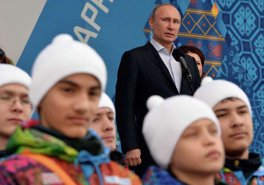 Russian President Vladimir Putin, speaking in the Olympic village this week, won the Games at a time the Russian economy was thriving. The recent slowdown has some doubting the wisdom of hosting the Olympics Photo: PASCAL LE SEGRETAIN, Stringer / 2014 Getty Images