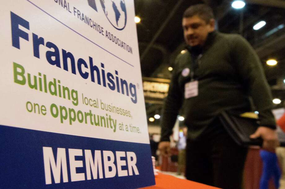Entrepreneur Chris Fonseca walks through the Franchise Expo in Reliant Center on Thursday, Feb. 6, 2014, in Houston.  Fonseca, 42, is looking to buy a franchise. ( J. Patric Schneider / For the Chronicle ) Photo: J. Patric Schneider, Freelance / © 2014 Houston Chronicle