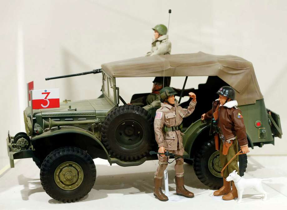 This Jan. 31, 2014 photo shows a Gen. George Patton G.I. Joe action figure, right, and other G.I. Joes in a display at the New York State Military Museum  in Saratoga Springs, N.Y. A half-century after the 12-inch doll was introduced at a New York City toy fair, the iconic action figure is being celebrated by collectors with a display at the military museum, while the toy's maker plans other anniversary events to be announced later this month. Photo: Mike Groll, AP / AP