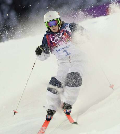 U.S. skier Hannah Kearney leads the qualifying in the women's freestyle skiing moguls competition with her time of 23.05 seconds at the Rosa Khutor Extreme Park in Sochi, Russia. Photo: Franck Fife / Getty Images / AFP