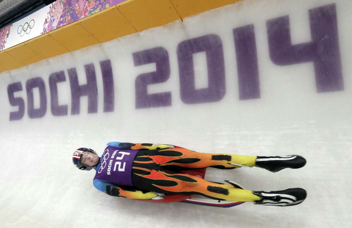 Tucker West of the United States takes a turn during a training session for the men's singles luge at the 2014 Winter Olympics, Thursday, Feb. 6, 2014, in Krasnaya Polyana, Russia. (AP Photo/Michael Sohn) ORG XMIT: OLYBO156