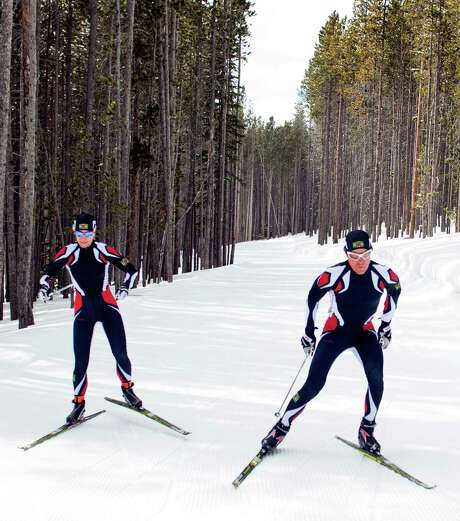 Cross-country skiers Gary di Silvestri, right, and Angelica di Silvestri, who live in New York, will represent the Caribbean island nation of Dominica at Sochi. Photo: Janie Osborne, FRE / FR170197 AP