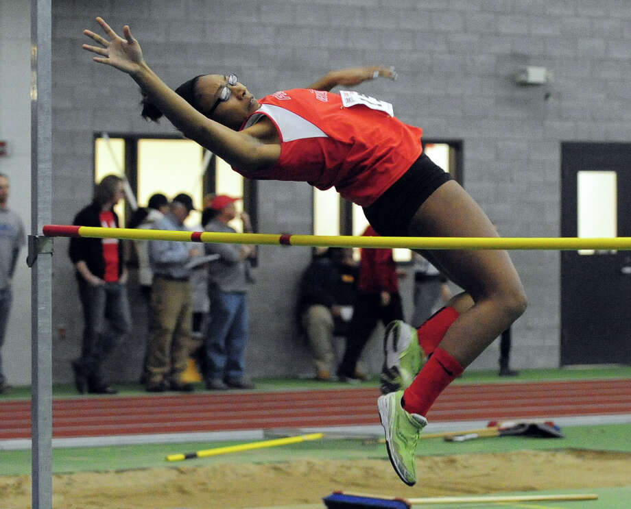 Fairfield Warde's Blossom Jean-Jacques competes in the high jump, during Class L Championship track action at Hillhouse High School's Floyd Little Athletic Center in New Haven, Conn. on Thursday February 6, 2014. Photo: Christian Abraham / Connecticut Post