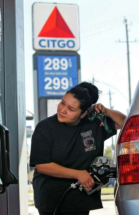 When Alma Montelongo filled up her SUV in Houston last October, the price was $2.99 a gallon. Though AAA says gasoline prices will start rising soon, the average price per gallon nationwide should be lower in 2014 than it was last year. Photo: Johnny Hanson, Staff / Houston Chronicle