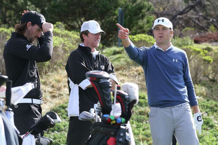 Jordan Spieth (right), who had the best round at Spyglass Hill (67), and country singer Jake Owen (left) look over a hole. Photo: Christian Petersen / Getty Images / 2014 Getty Images